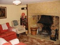 17th century inglenook fireplace, in one of the sitting rooms in Myrtle House